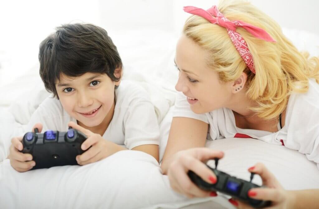 photo of mom and son playing video games